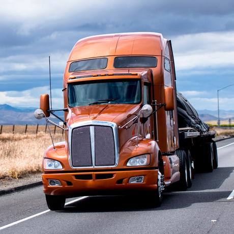 Transportation OTR Orange Semi Truck