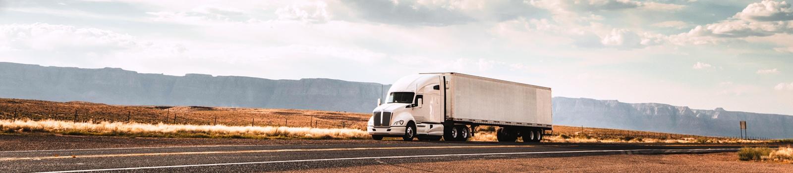 Transportation White Semi Truck Highway Approaching