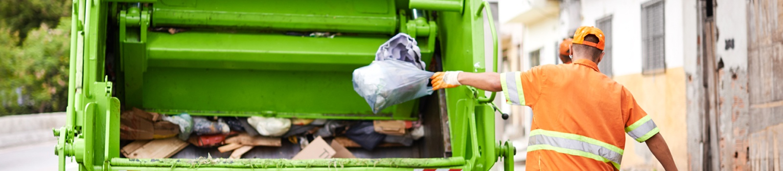 Waste Worker Loading Garbage Truck