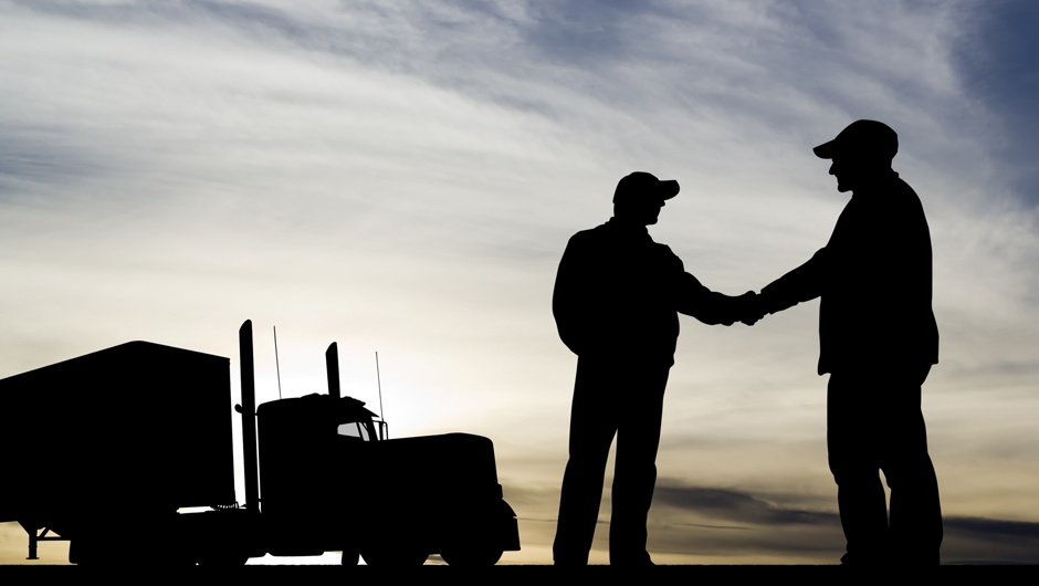 trucker-silhouette-shaking-hands