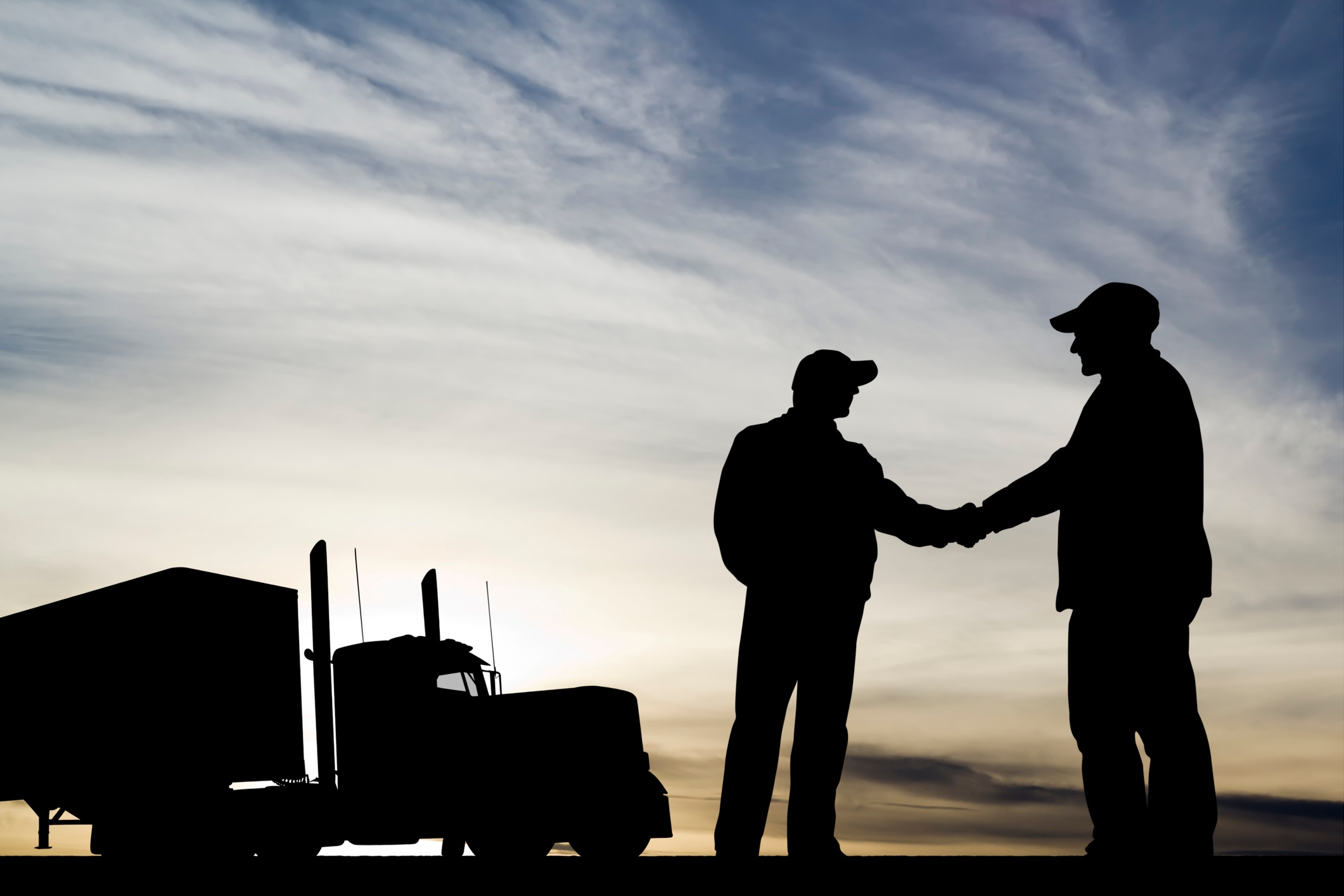Trucker silhouette shaking hands-1